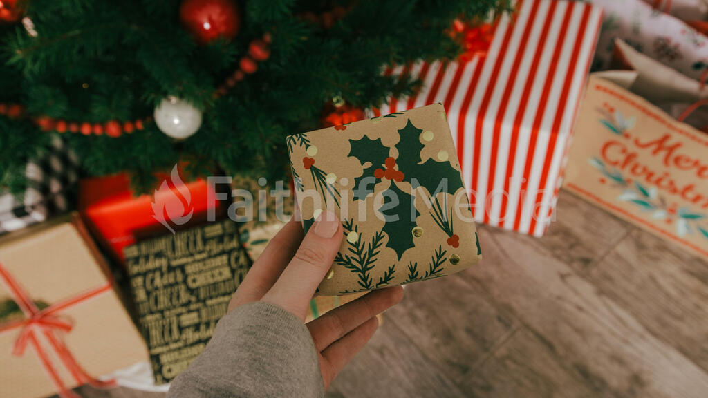 Placing a Christmas Present under the Tree large preview