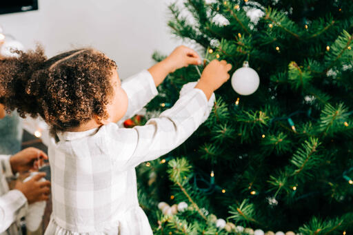 Child Decorating the Christmas Tree