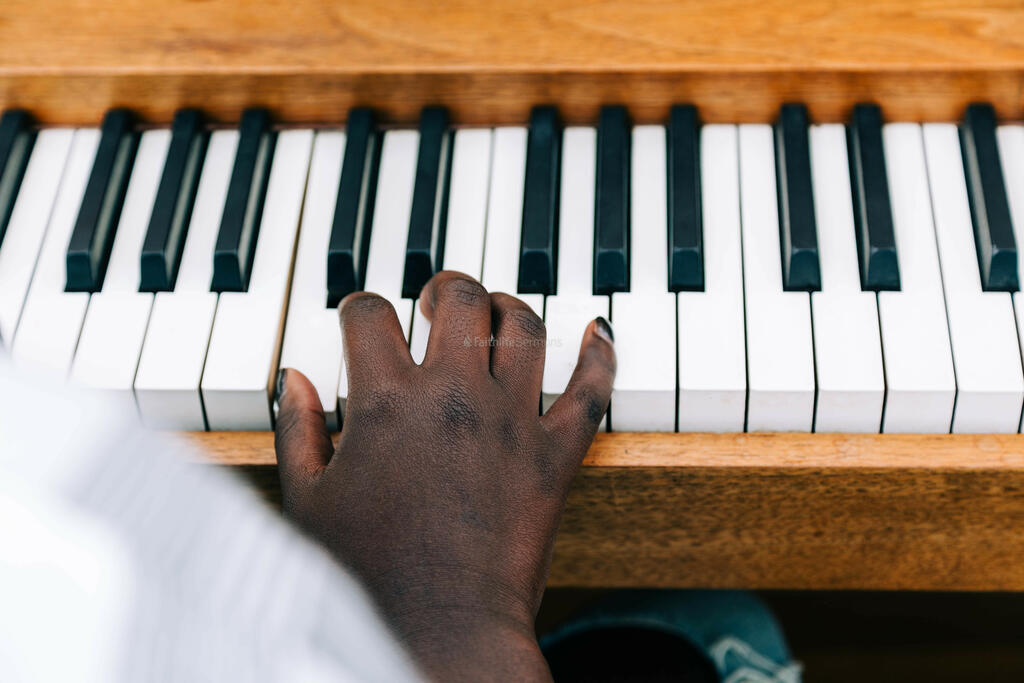 Woman's Hand on Keys of Piano large preview