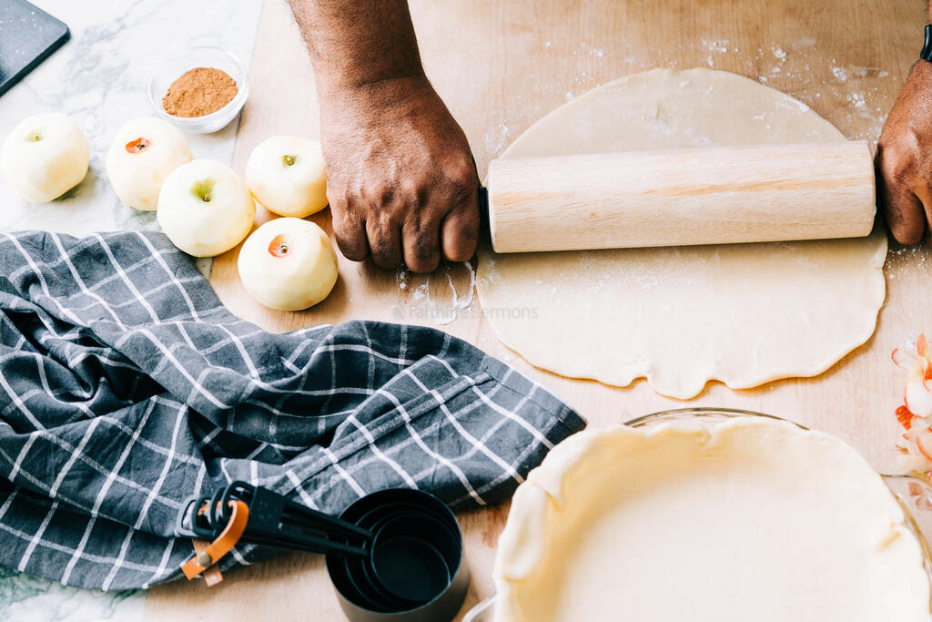 Man Rolling Out Crust for Apple Pie large preview