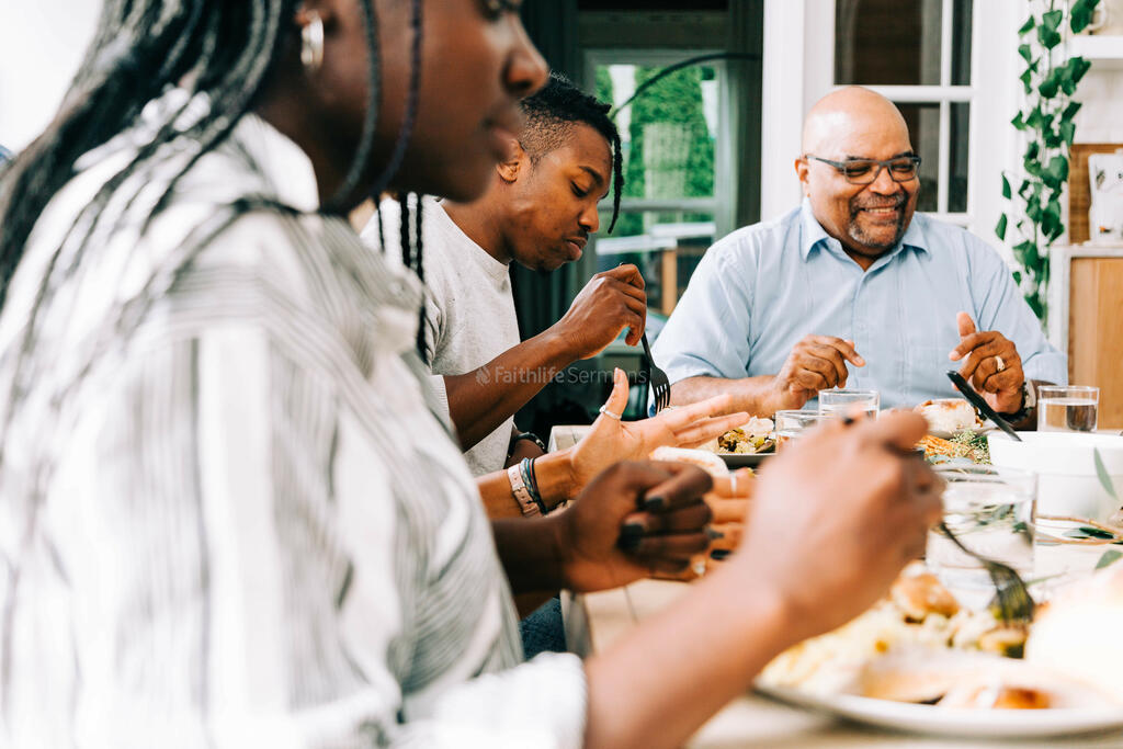 Family Enjoying Thanksgiving Meal Together large preview