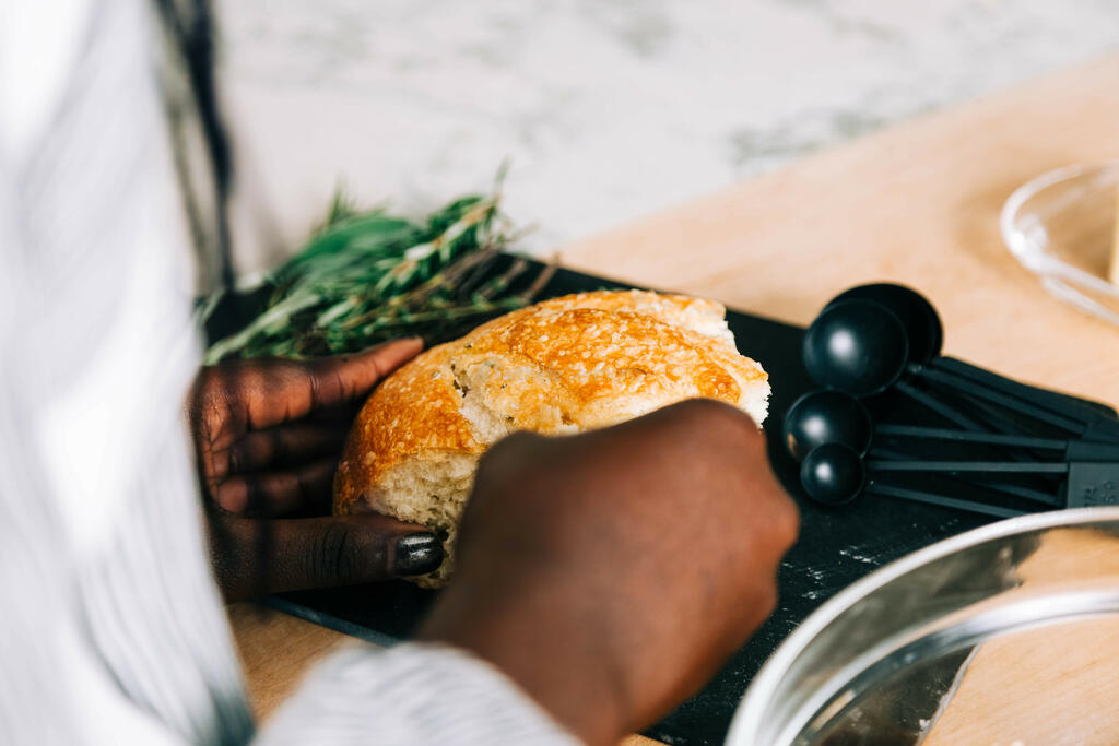 Woman Tearing Bread for Thanksgiving Stuffing large preview