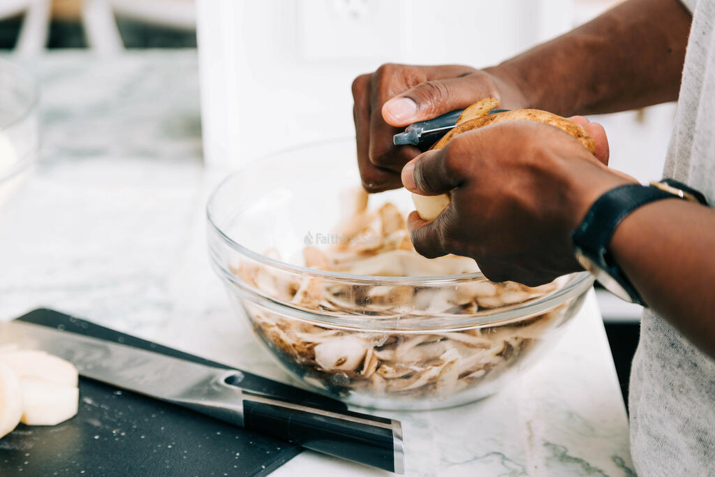 Man Peeling Potatoes large preview