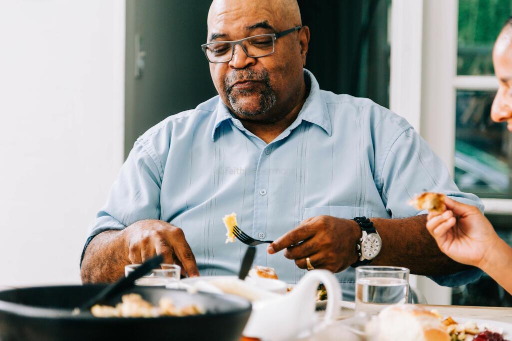 Man Enjoying the Thanksgiving Meal large preview