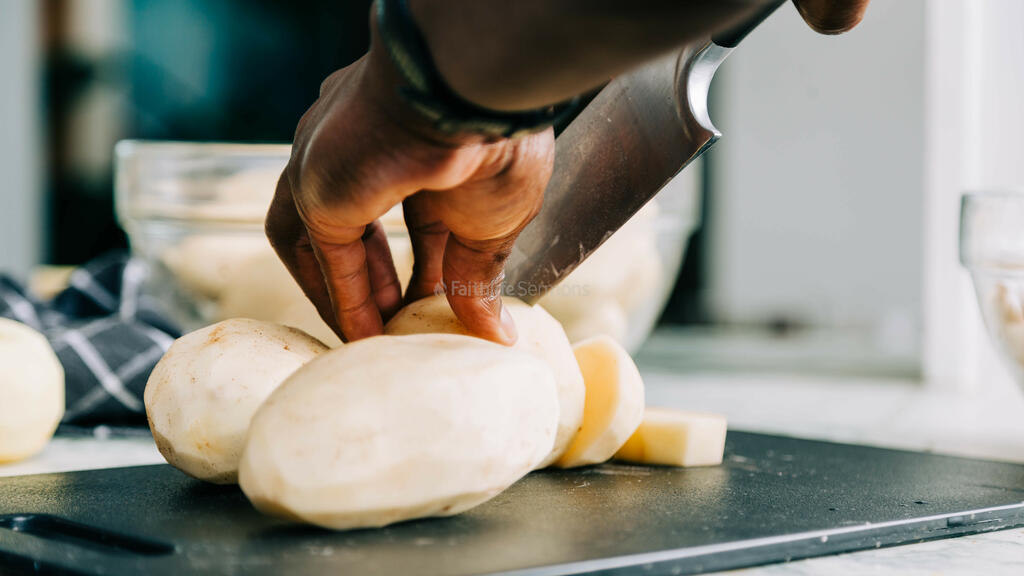 Man Chopping Potatoes large preview