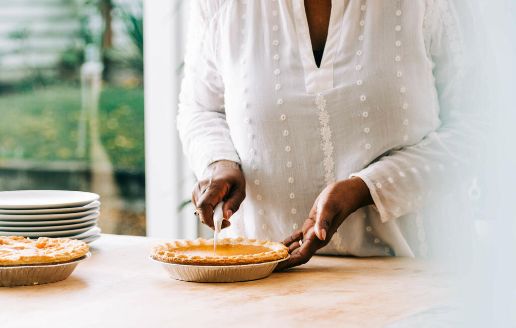 Woman Slicing Pumpkin Pie large preview
