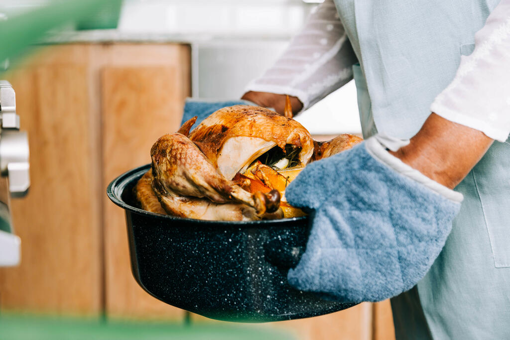 Woman Holding Thanksgiving Turkey large preview