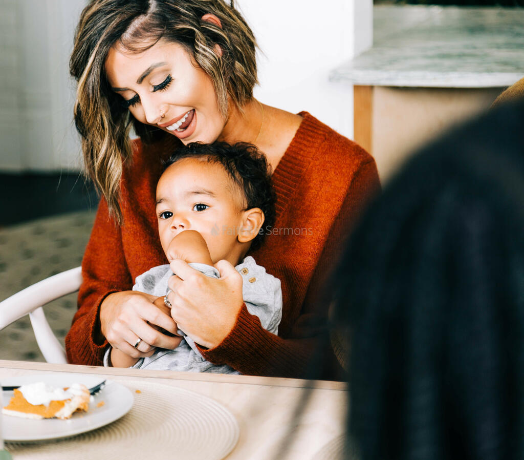 Woman Laughing at Thanksgiving Table, Holding Baby large preview