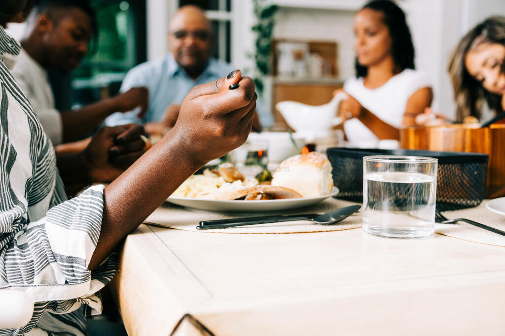 Woman Enjoying Thanksgiving Dinner with Family large preview