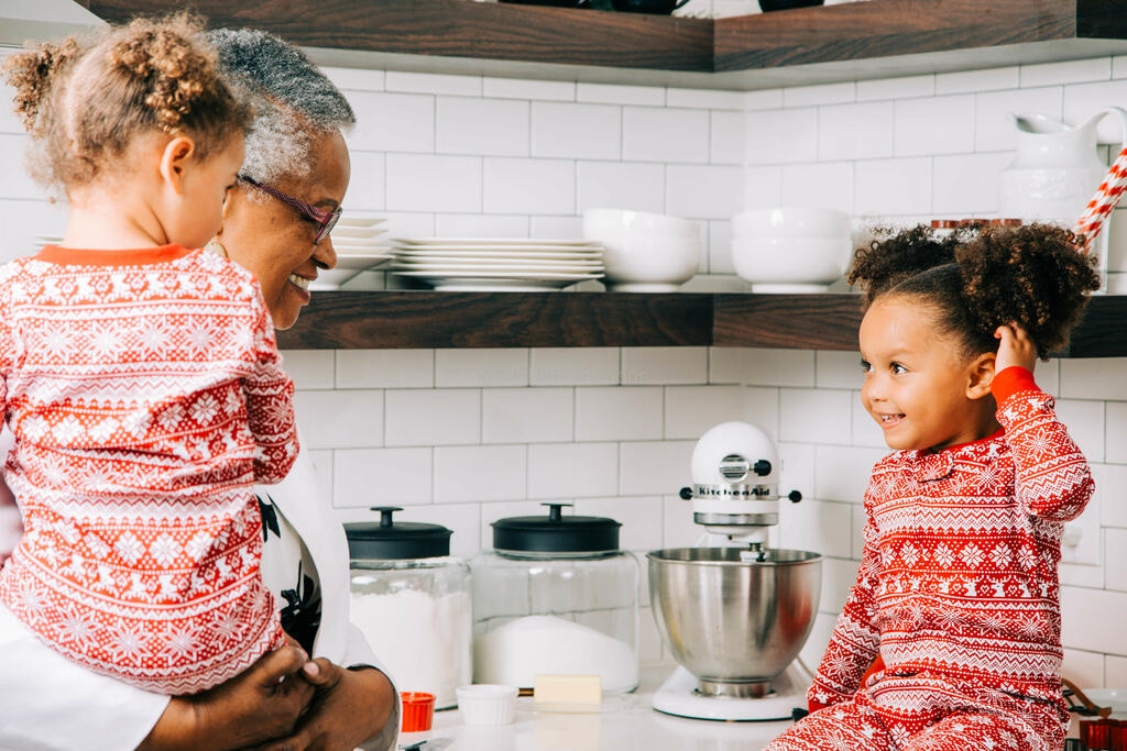 Woman Baking Christmas Cookies with her Grandchildren large preview