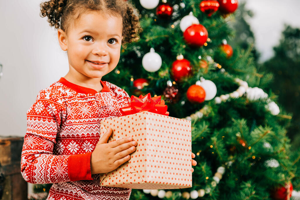 Child Holding a Christmas Present large preview