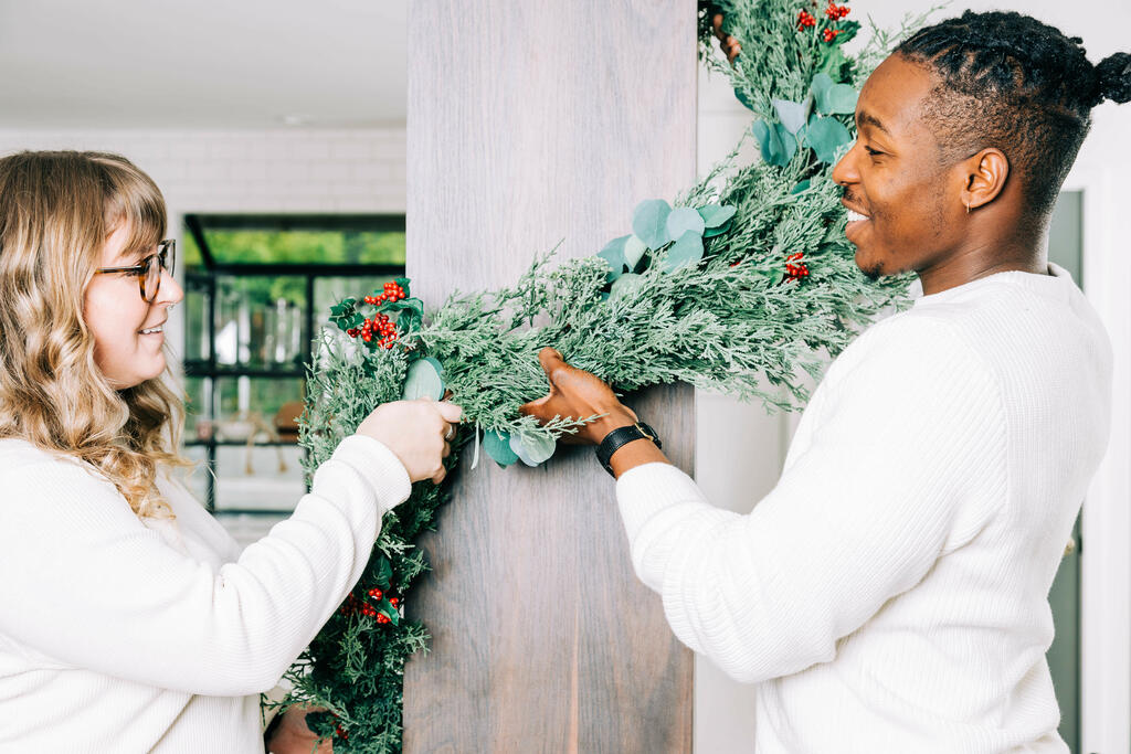 Married Couple Decorating for Christmas large preview