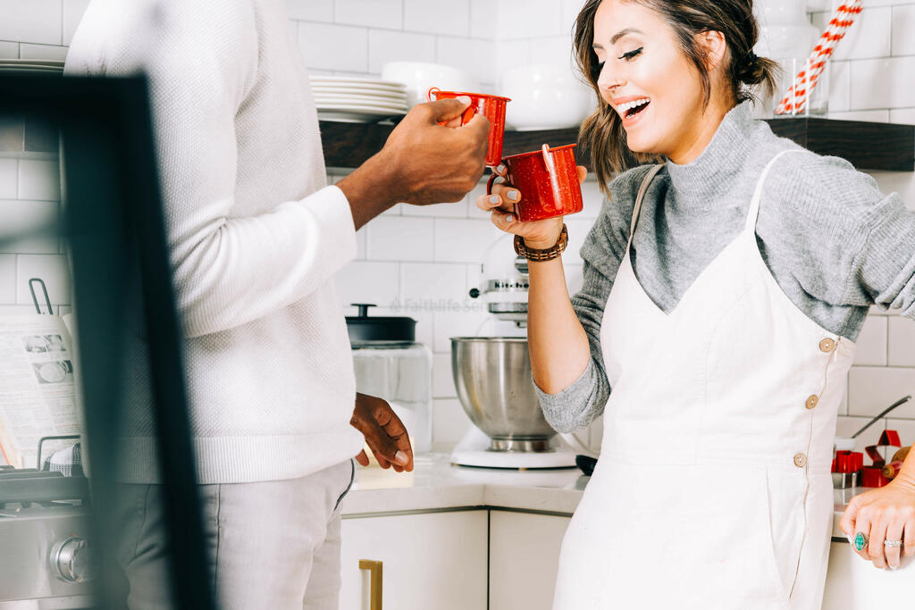 Married Couple Cheersing Cups of Hot Cocoa large preview