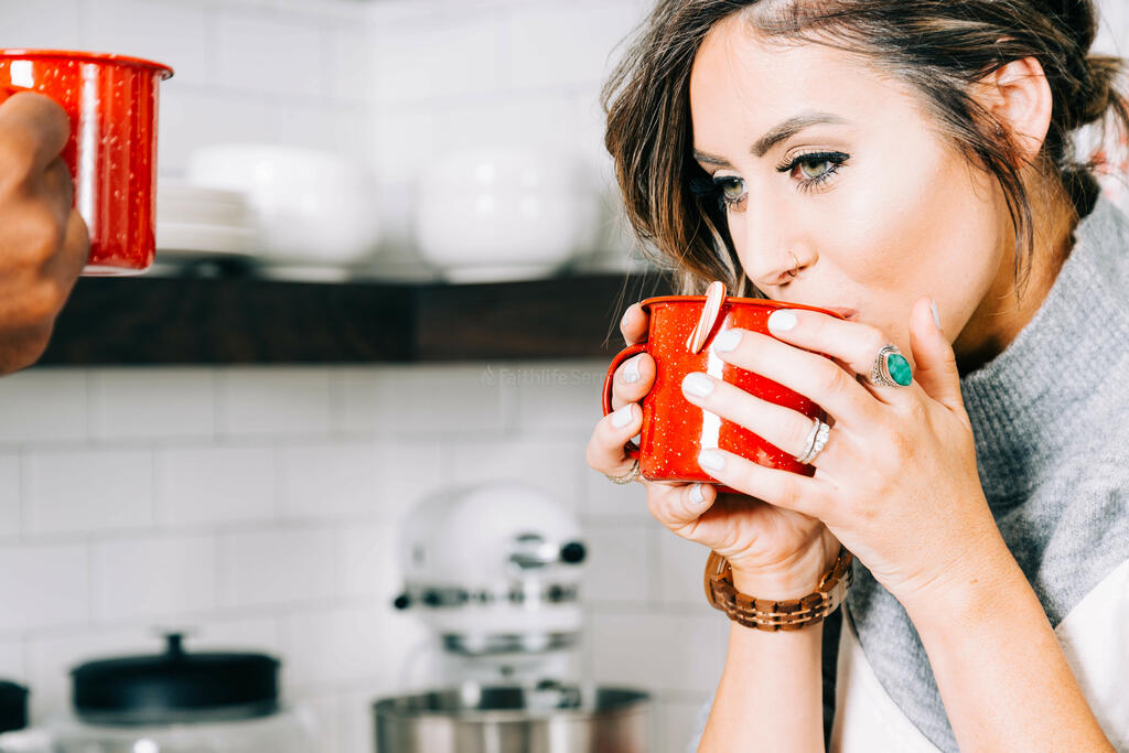 Woman Drinking Hot Cocoa large preview