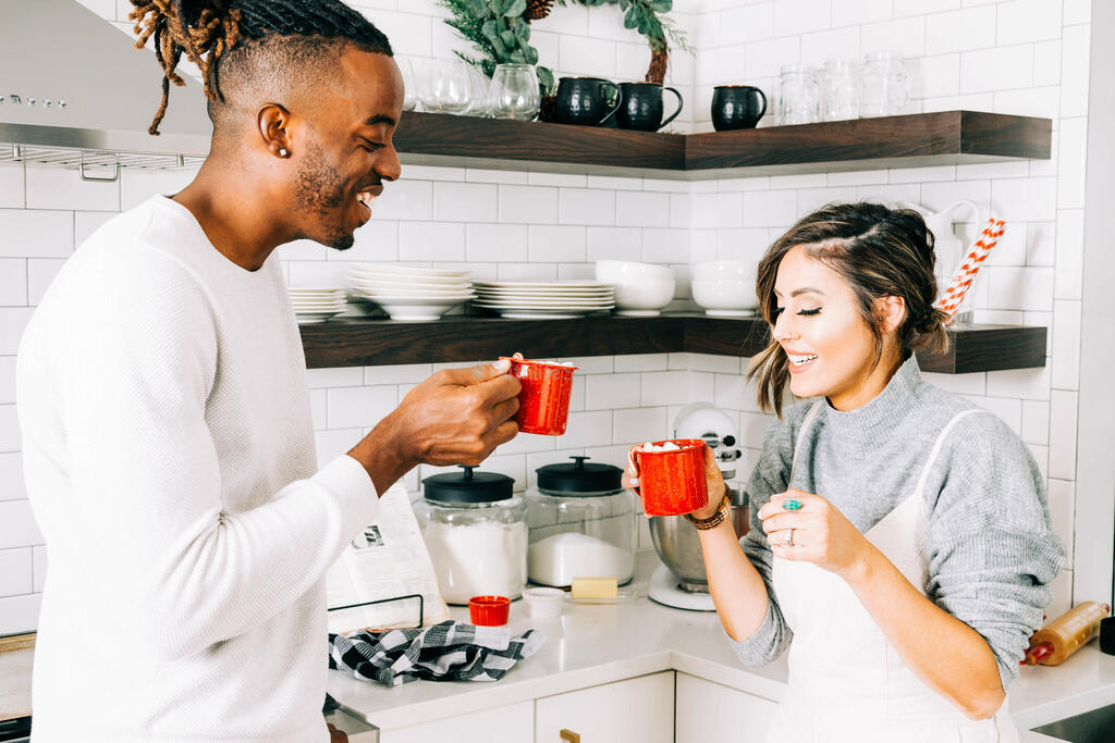 Married Couple Drinking Hot Cocoa Together large preview