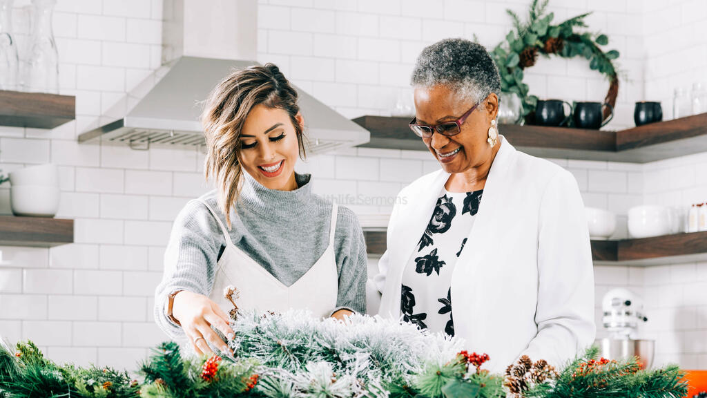 Women Making a Christmas Wreath Together large preview