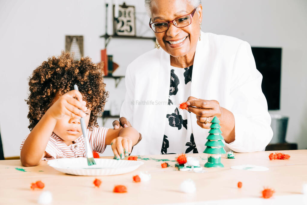 Grandmother and Grandson Doing a Christmas Craft Together large preview