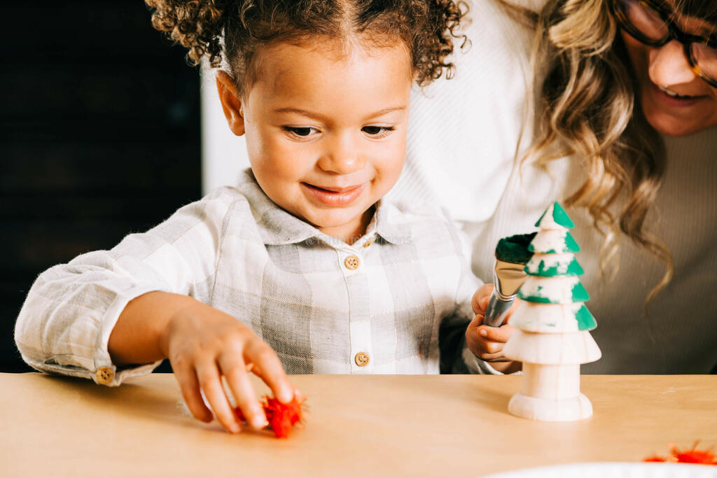 Child Doing a Christmas Craft large preview