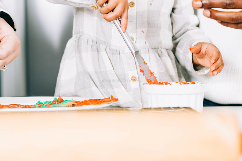 Child Frosting Christmas Cookies large preview