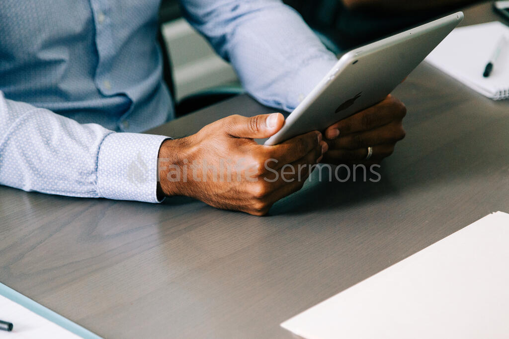 Man Using an iPad During a Meeting large preview