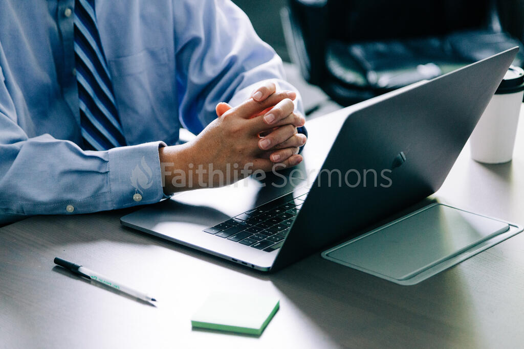 Man with Hands Folded at Desk large preview