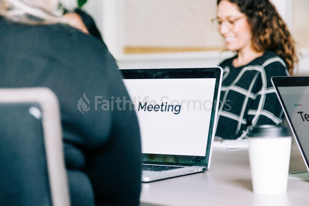 People Seated at Conference Table with Laptops Out for a Meeting large preview