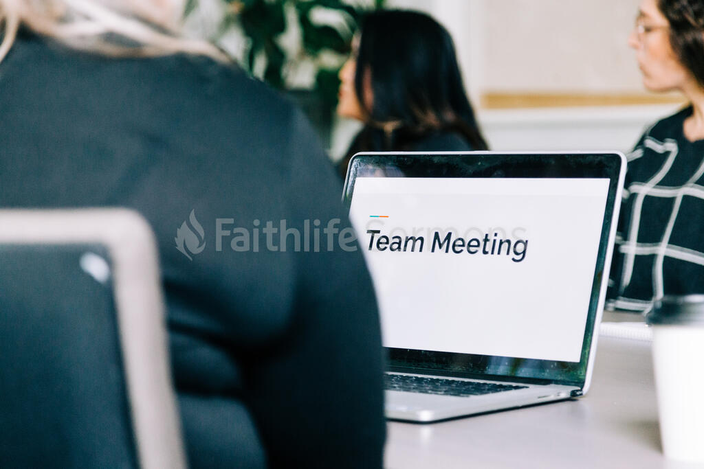 Woman Seated at Conference Table with Laptop Open During a Meeting large preview