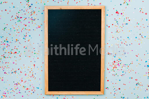 Letterboard Surrounded by Confetti