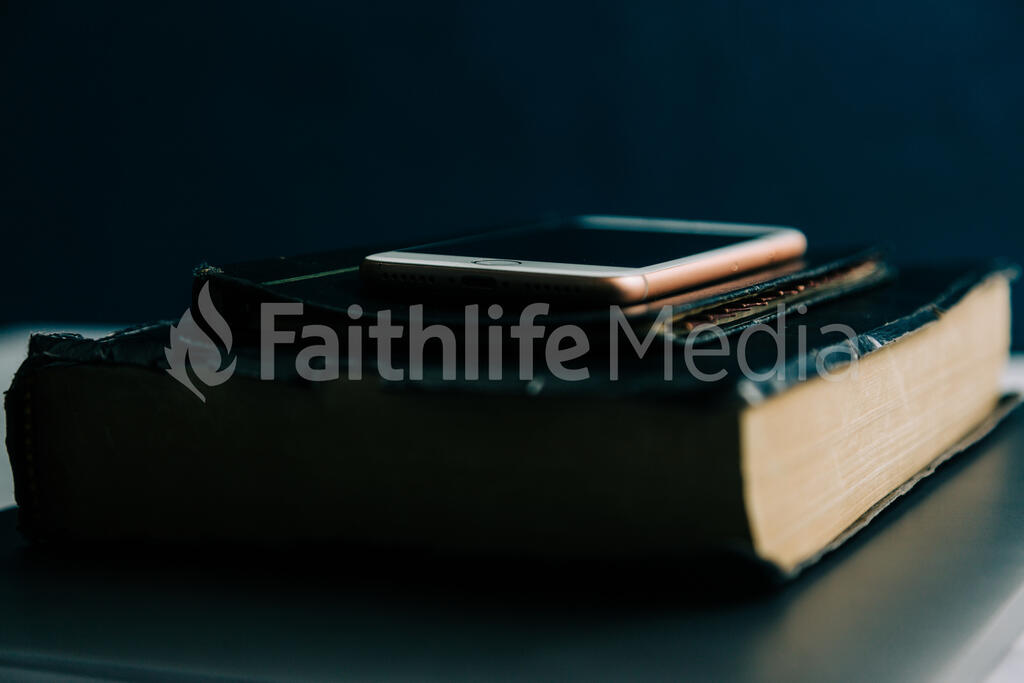Laptop, Bible, Notepad and Smart Phone Stacked large preview