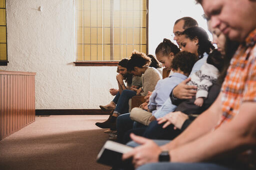 Congregation Members Praying Together