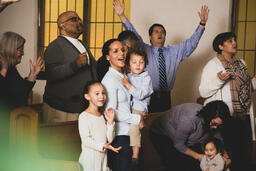 Young Family During Worship on a Sunday Morning  image 4