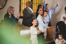 Young Family During Worship on a Sunday Morning  image 1