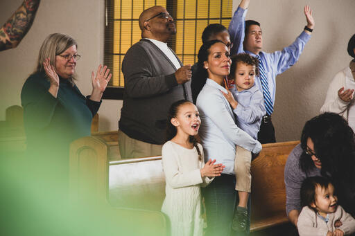 Young Family During Worship on a Sunday Morning
