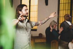 Man Worshipping on a Sunday Morning  image 1