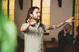 Man Worshipping on a Sunday Morning  image 3