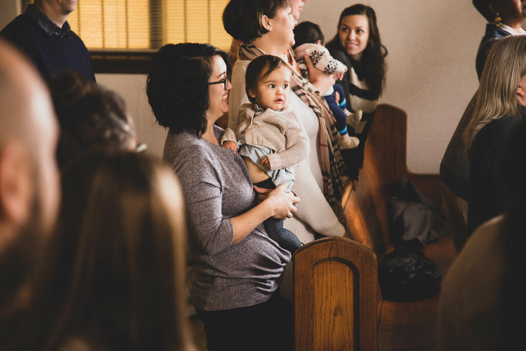 Mother Holding Baby at Church large preview