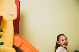 Young Girl on a Slide  image 6