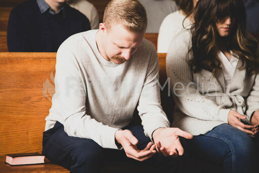 Congregation Members Praying