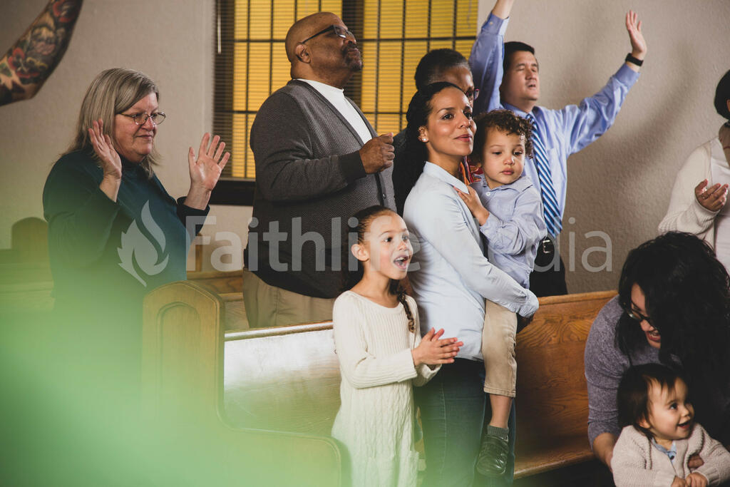Young Family During Worship on a Sunday Morning large preview
