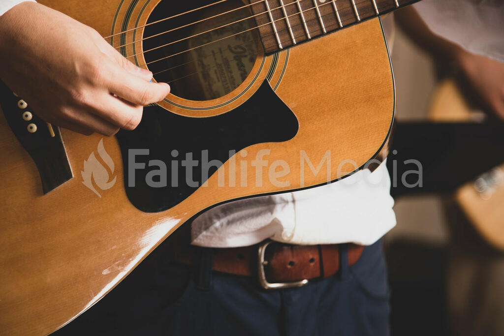 Person Playing Acoustic Guitar large preview