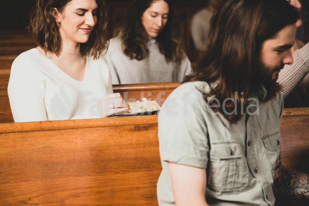 Woman Grabbing Bread During Communion large preview