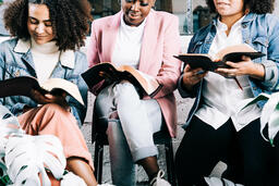 Young Women Reading the Bible Together  image 1