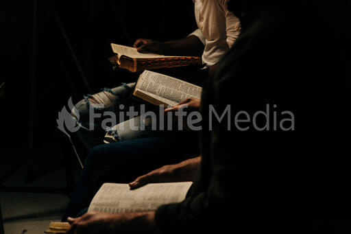 Small Group Reading the Bible Together in Living Room