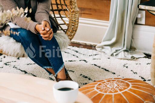 Woman Praying in Living Room