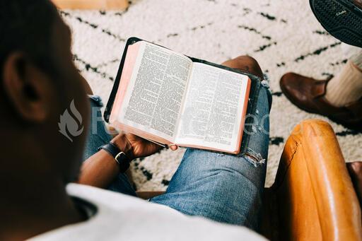 Man Reading Bible at Small Group