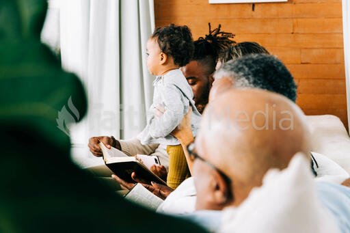 Young Family Seated on the Couch at Small Group
