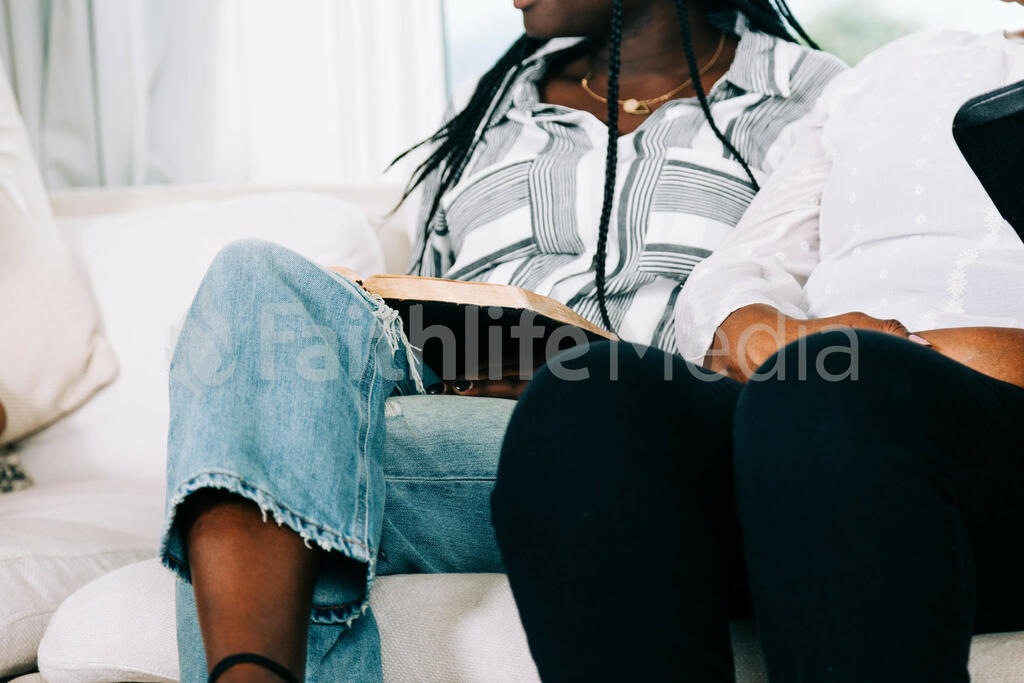 Woman with Open Bible on her Lap at Small Group large preview