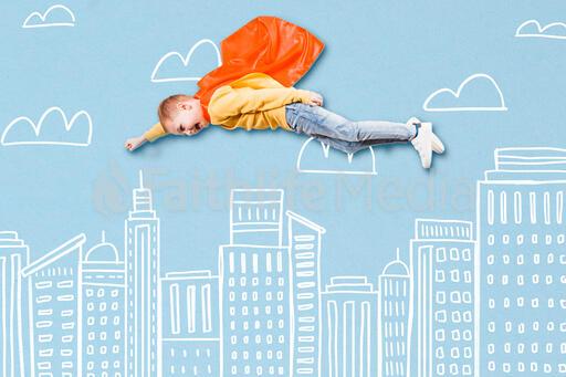 Boy Super Hero Flying Above an Illustrated City Skyline
