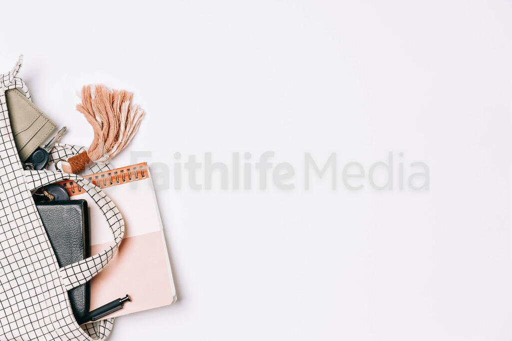 Handbag with Wallet, Keys, Notebook and Bible Spilling Out large preview