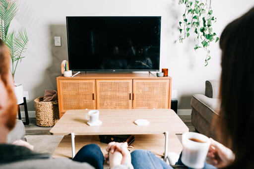 Couple Watching Church at Home on a TV